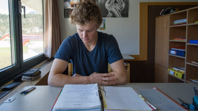 Student Max Lahnsteiner does his homeworks in his room at the ski high school Schigymnasium in Stams, Austria on October 27, 2014. Many of the world's top skiers have walked the halls of the school founded nearly 50 years ago. About 60 teachers and 27 trainers -- many with links to the Austrian ski team -- cater to the 170-180 students, who spend four or five years here depending on whether they do a high school diploma or choose the business college (Handelsschule) option. AFP PHOTO /JOE KLAMAR +++ RESTRICTED TO EDITORIAL USE        (Photo credit should read JOE KLAMAR/AFP/Getty Images)