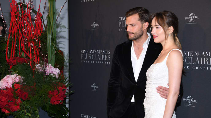 "PARIS, FRANCE - FEBRUARY 06:  Jamie Dornan and Dakota Johnson attend ""Fifty Shades Freed - 50 Nuances Plus Claires"" Premiere at Salle Pleyel on February 6, 2018 in Paris, France.  (Photo by Pascal Le Segretain/Getty Images)"