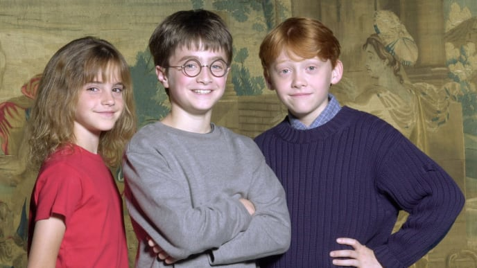 376506 01: Warner Bros. Pictures announced August 21, 2000 that the young actor Daniel Radcliffe, center, has been named as the young actor who will play Harry Potter, in the upcoming film adaptation of the popular books by J.K. Rowling. Newcomers Rupert Grint, right, and Emma Watson will be taking on the roles of Ron and Hermione, Harry's best friends at Hogwarts. (Courtesy of Warner Bros./Newsmakers)