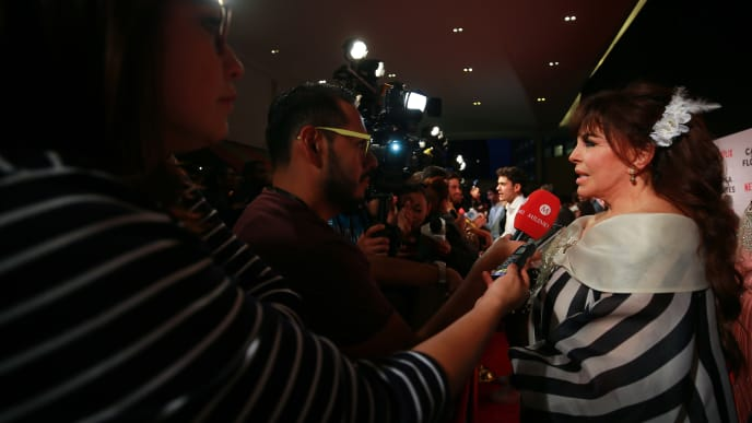 """MEXICO CITY, MEXICO - AUGUST 08: Veronica Castro speaks to the media during the avant premiere of Netflix series """"La Casa de Las Flores"""" at Cinemex Antara on August 08, 2018 in Mexico City, Mexico. (Photo by Manuel Velasquez/Getty Images)"""