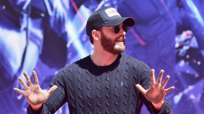 """HOLLYWOOD, CA - APRIL 23:  Marvel Studios' """"Avengers: Endgame"""" star Chris Evans at the Hand And Footprint Ceremony at the TCL Chinese Theatre on April 23, 2019 in Hollywood, California.  (Photo by Alberto E. Rodriguez/Getty Images for Disney)"""