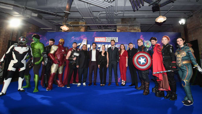 "LONDON, ENGLAND - APRIL 10:  (centre L-R) Joe Russo, Paul Rudd, Scarlett Johansson, Chris Hemsworth, Trinh Tran and Anthony Russo pose with Marvel characters as they attend the UK Fan Event to celebrate the release of Marvel Studios' ""Avengers: Endgame"" at Picturehouse Central on April 10, 2019 in London, England. (Photo by Eamonn M. McCormack/Getty Images for Disney)"