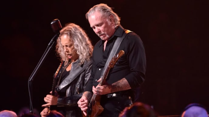 "SAN FRANCISCO, CALIFORNIA - SEPTEMBER 06: Kirk Hammett (L) and James Hetfield of Metallica perform during the ""S&M2"" concerts at the opening night at Chase Center on September 06, 2019 in San Francisco, California. (Photo by Tim Mosenfelder/Getty Images)"