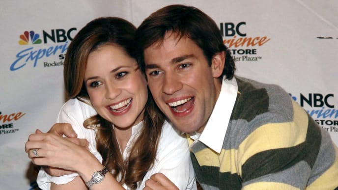 """NEW YORK - SEPTEMBER 21:  Actors John Krasinski (R) and Jenna Fischer attend the """"The Office"""" DVD release signing at the NBC Experience store September 21, 2006 in New York City.  (Photo by Gustavo Caballero/Getty Images)"""