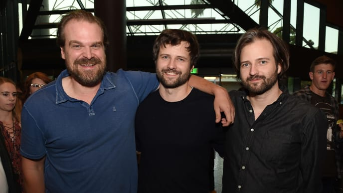 "LOS ANGELES, CA - AUGUST 17:  (L-R) Actor David Harbour, creators, writers, executive producers Ross Duffer and Matt Duffer arrive at a reception and q&a for Netflix's ""Stranger Thing"" at the Directors Guild on August 17, 2017 in Los Angeles, California.  (Photo by Kevin Winter/Getty Images)"