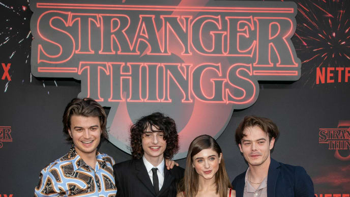 "PARIS, FRANCE - JULY 04: (L-R) Actors Joe Keery, Finn Wolfhard, Natalia Dyer and Charlie Heaton attend the Premiere Of Netflix's ""Stranger Things"" At Le Grand Rex on July 04, 2019 in Paris, France. (Photo by Marc Piasecki/Getty Images)"