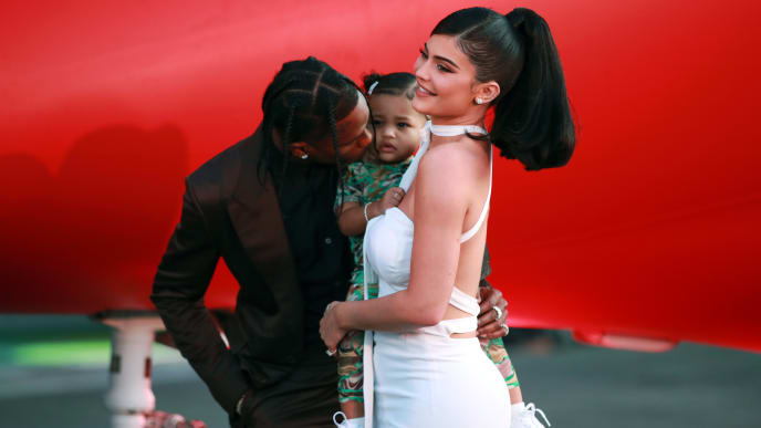 "SANTA MONICA, CALIFORNIA - AUGUST 27: (L-R) Travis Scott, Stormi Webster, and Kylie Jenner attend the premiere of Netflix's ""Travis Scott: Look Mom I Can Fly"" at Barker Hangar on August 27, 2019 in Santa Monica, California. (Photo by Rich Fury/Getty Images)"