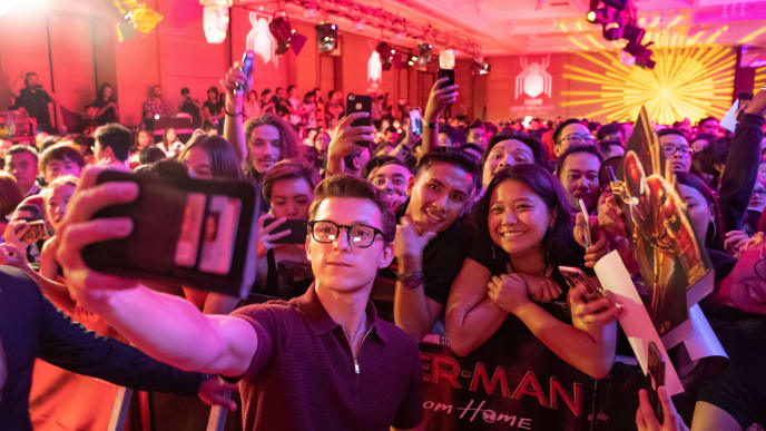 DENPASAR, BALI, INDONESIA - MAY 27: Tom Holland takes selfie with fans during the Spider-Man: Far From Home Pan-Asian Media Summit Bali event on May 27, 2019 in Denpasar, Bali, Indonesia. (Photo by Anthony Kwan/Getty Images for Sony Pictures Entertainment )