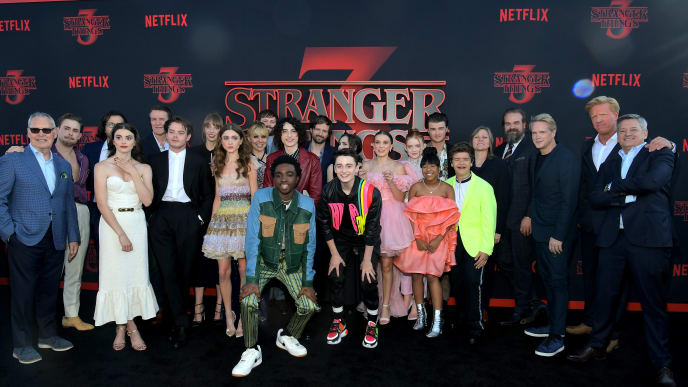 """SANTA MONICA, CALIFORNIA - JUNE 28: Stranger Things cast and crew pose with Netflix execs at the """"Stranger Things"""" Season 3 World Premiere on June 28, 2019 in Santa Monica, California. (Photo by Charley Gallay/Getty Images for Netflix)"""
