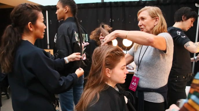 NEW YORK, NY - FEBRUARY 10:  Stylist Odile Gilbert prepares models backstage for TRESemme at Prabal Gurung during NYFW on February 10, 2019 in New York City.  (Photo by Astrid Stawiarz/Getty Images for TRESemme)