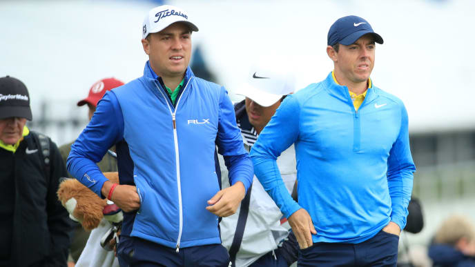 PORTRUSH, NORTHERN IRELAND - JULY 17: Justin Thomas of the United States and Rory McIlroy of Northern Ireland walk down the 2nd hole during a practice round prior to the 148th Open Championship held on the Dunluce Links at Royal Portrush Golf Club on July 17, 2019 in Portrush, United Kingdom. (Photo by Andrew Redington/Getty Images)