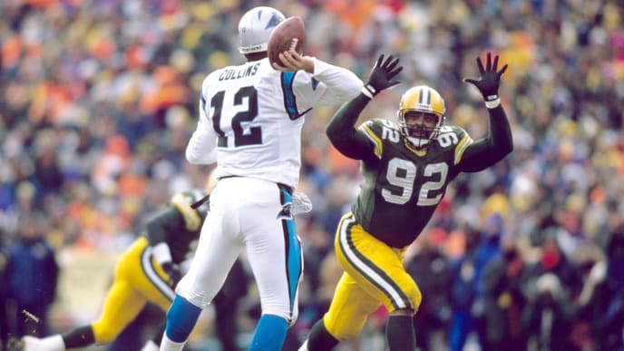 Green Bay Packers Hall of Fame defensive end Reggie White (92) closes in on Carolina Panthers quarterback Kerry Collins (12) during the NFC Championship Game, a 30-13 Packers victory on January 12, 1997, at Lambeau Field in Green Bay, Wisconsin. (Photo by Allen Kee/Getty Images)