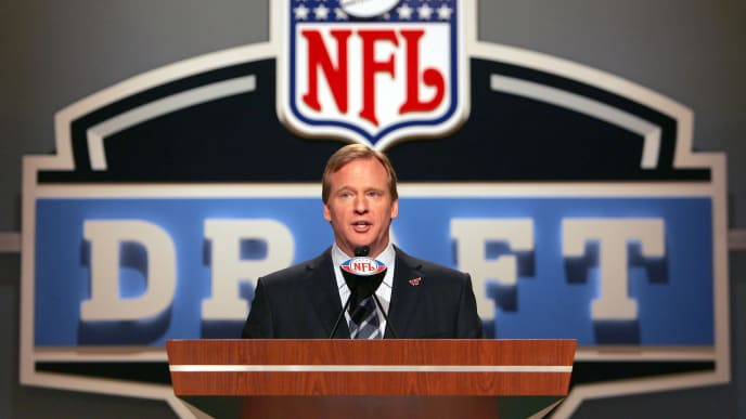 NFL commissioner Roger Goodell takes the podium to announce an NFL Draft pick.