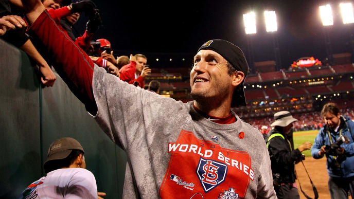 ST LOUIS, MO - OCTOBER 28:  World Series MVP David Freese #23 of the St. Louis Cardinals celebrates with fans after defeating the Texas Rangers 6-2 to win Game Seven of the MLB World Series at Busch Stadium on October 28, 2011 in St Louis, Missouri.  (Photo by Dilip Vishwanat/Getty Images)
