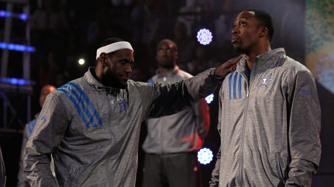 ORLANDO, FL - FEBRUARY 26:  (L-R) LeBron James #6 of the Miami Heat and the Eastern Conference and Dwight Howard #12 of the Orlando Magic and the Eastern Conference react during player introductions for the 2012 NBA All-Star Game at the Amway Center on February 26, 2012 in Orlando, Florida.  NOTE TO USER: User expressly acknowledges and agrees that, by downloading and or using this photograph, User is consenting to the terms and conditions of the Getty Images License Agreement.  (Photo by Ronald Martinez/Getty Images)
