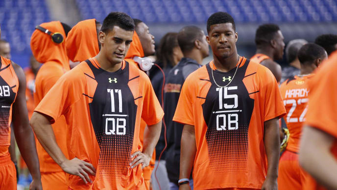 INDIANAPOLIS, IN - FEBRUARY 21: Quarterbacks Marcus Mariota #11 of Oregon and Jameis Winston #15 of Florida State look on during the 2015 NFL Scouting Combine at Lucas Oil Stadium on February 21, 2015 in Indianapolis, Indiana. (Photo by Joe Robbins/Getty Images)