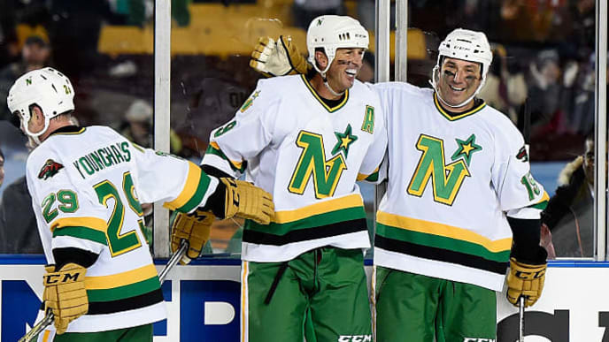 MINNEAPOLIS, MN - FEBRUARY 20: (L-R) Tom Younghans #29, Mike Modano #9 and Andrew Brunette #15 of the Minnesota North Stars/Wild Alumni celebrate a goal against the Chicago Blackhawks Alumni by Modano in the third period during the alumni game at the 2016 Coors Light Stadium Series on February 20, 2016 at TCF Bank Stadium in Minneapolis, Minnesota. The North Stars/Wild Alumni defeated the Blackhawks Alumni 6-4. (Photo by Hannah Foslien/Getty Images)