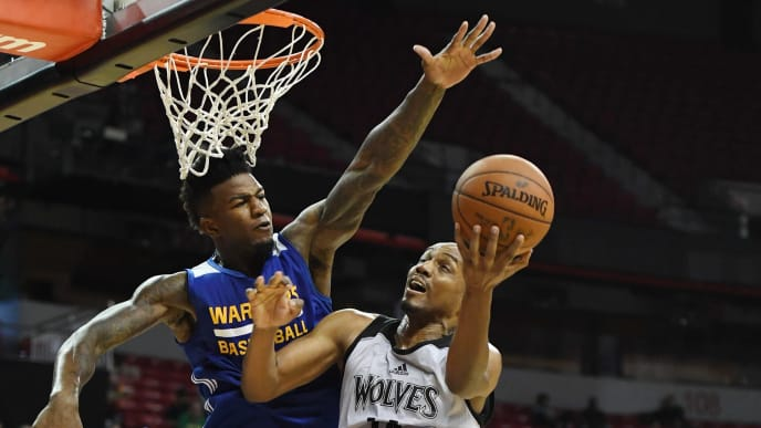 LAS VEGAS, NV - JULY 12:  C.J. Williams #14 of the Minnesota Timberwolves drives to the basket against Jordan Bell #2 of the Golden State Warriors during the 2017 Summer League at the Thomas & Mack Center on July 12, 2017 in Las Vegas, Nevada. Golden State won 77-69. NOTE TO USER: User expressly acknowledges and agrees that, by downloading and or using this photograph, User is consenting to the terms and conditions of the Getty Images License Agreement.  (Photo by Ethan Miller/Getty Images)