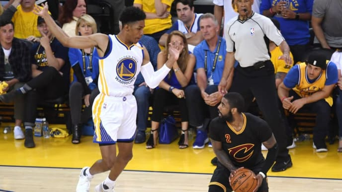 OAKLAND, CA - JUNE 12: Kyrie Irving #2 of the Cleveland Cavaliers is defended by Patrick McCaw #0 of the Golden State Warriors during the first half in Game 5 of the 2017 NBA Finals at ORACLE Arena on June 12, 2017 in Oakland, California. NOTE TO USER: User expressly acknowledges and agrees that, by downloading and or using this photograph, User is consenting to the terms and conditions of the Getty Images License Agreement.  (Photo by Thearon W. Henderson/Getty Images)