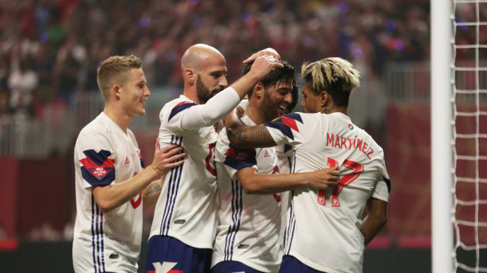 ATLANTA, GA - AUGUST 01: Josef Martinez of MLS All-Stars celebrates with teammate Carlos Vela after scoring the equalizer during a match between Juventus and MLS All-Stars at Mercedes-Benz Stadium on August 1, 2018 in Atlanta, Georgia. (Photo by Omar Vega/Getty Images)
