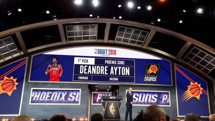 NEW YORK, NY - JUNE 21: NBA Commissioner Adam Silver announces Deandre Ayton as the first pick by the Phoenix Suns during the 2018 NBA Draft at the Barclays Center on June 21, 2018 in the Brooklyn borough of New York City. NOTE TO USER: User expressly acknowledges and agrees that, by downloading and or using this photograph, User is consenting to the terms and conditions of the Getty Images License Agreement.  (Photo by Mike Lawrie/Getty Images)
