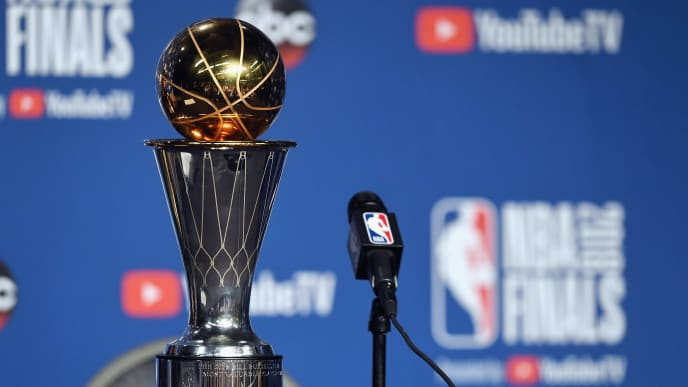 CLEVELAND, OH - JUNE 08: The 2018 NBA Finals MVP trophy sits near the microphone before the press conference for Kevin Durant #35 of the Golden State Warriors after defeating the Cleveland Cavaliers during Game Four of the 2018 NBA Finals at Quicken Loans Arena on June 8, 2018 in Cleveland, Ohio. The Warriors defeated the Cavaliers 108-85 to win the 2018 NBA Finals.  NOTE TO USER: User expressly acknowledges and agrees that, by downloading and or using this photograph, User is consenting to the terms and conditions of the Getty Images License Agreement.  (Photo by Jason Miller/Getty Images)