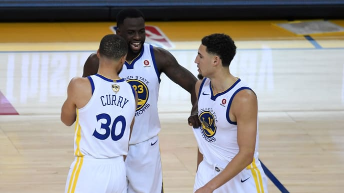 OAKLAND, CA - MAY 31:  Draymond Green #23 of the Golden State Warriors celebrates with Stephen Curry #30 and Klay Thompson #11 against the Cleveland Cavaliers in Game 1 of the 2018 NBA Finals at ORACLE Arena on May 31, 2018 in Oakland, California. NOTE TO USER: User expressly acknowledges and agrees that, by downloading and or using this photograph, User is consenting to the terms and conditions of the Getty Images License Agreement.  (Photo by Thearon W. Henderson/Getty Images)
