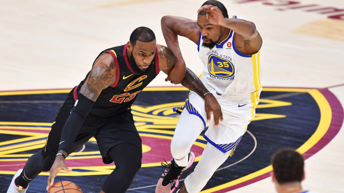 CLEVELAND, OH - JUNE 06:  LeBron James #23 of the Cleveland Cavaliers drives against Kevin Durant #35 of the Golden State Warriors during Game Three of the 2018 NBA Finals at Quicken Loans Arena on June 6, 2018 in Cleveland, Ohio. NOTE TO USER: User expressly acknowledges and agrees that, by downloading and or using this photograph, User is consenting to the terms and conditions of the Getty Images License Agreement.  (Photo by Jamie Sabau/Getty Images)