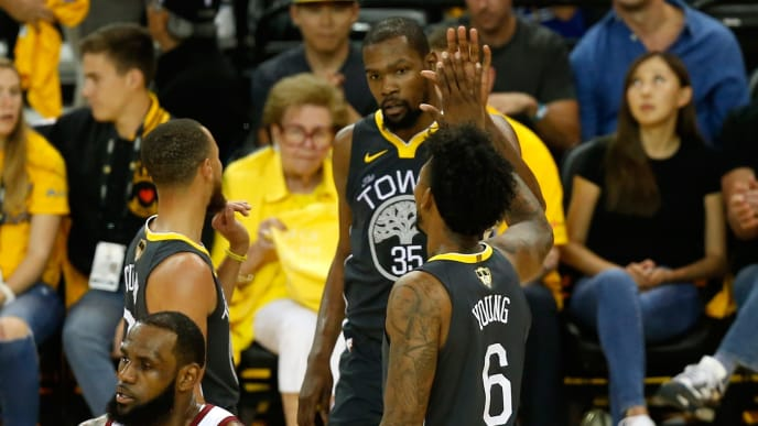 OAKLAND, CA - JUNE 03:  Kevin Durant #35 of the Golden State Warriors celerbates with Stephen Curry #30 and Nick Young #6 against the Cleveland Cavaliers during the second quarter in Game 2 of the 2018 NBA Finals at ORACLE Arena on June 3, 2018 in Oakland, California. NOTE TO USER: User expressly acknowledges and agrees that, by downloading and or using this photograph, User is consenting to the terms and conditions of the Getty Images License Agreement.  (Photo by Lachlan Cunningham/Getty Images)