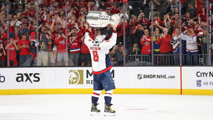 LAS VEGAS, NV - JUNE 07:  Alex Ovechkin #8 of the Washington Capitals carries the Stanley Cup in celebration after his team defeated the Vegas Golden Knights 4-3 in Game Five of the 2018 NHL Stanley Cup Final at the T-Mobile Arena on June 7, 2018 in Las Vegas, Nevada.  (Photo by Bruce Bennett/Getty Images)