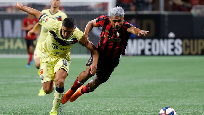 ATLANTA, GEORGIA - AUGUST 14:  Bruno Valdez #18 of Club America earns his second yellow card that was quickly followed by a red card after this challenge against Josef Martinez #7 of Atlanta United during the final of the Campeones Cup between Club America and Atlanta United at Mercedes-Benz Stadium on August 14, 2019 in Atlanta, Georgia. (Photo by Kevin C. Cox/Getty Images)
