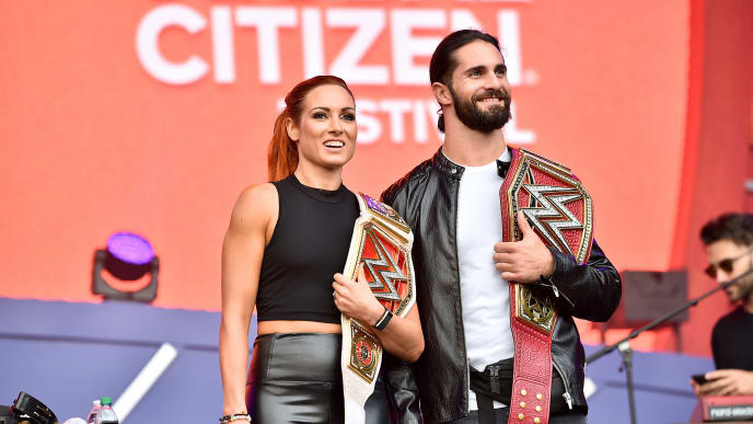 NEW YORK, NEW YORK - SEPTEMBER 28: Becky Lynch and Seth Rollins speak onstage during the 2019 Global Citizen Festival: Power The Movement in Central Park on September 28, 2019 in New York City. (Photo by Theo Wargo/Getty Images for Global Citizen)