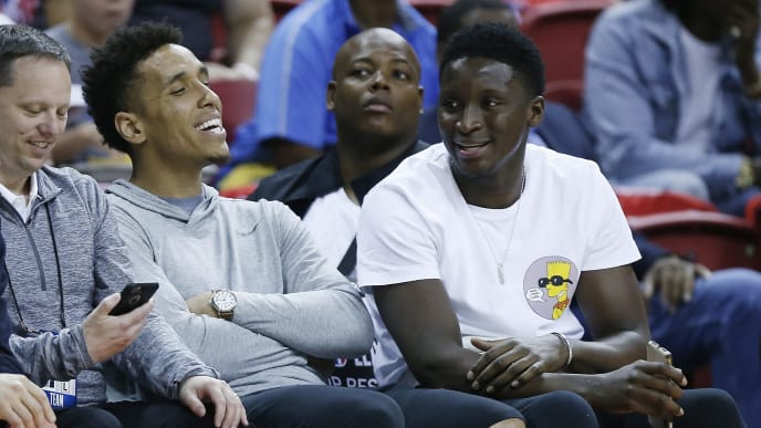 LAS VEGAS, NEVADA - JULY 09: Malcom Brogdon (L) and Victor Oladipo of the Indiana Pacers (R) look on during the 2019 Summer League game between the Atlanta Hawks and the Indiana Pacers at the Thomas & Mack Center on July 09, 2019 in Las Vegas, Nevada. NOTE TO USER: User expressly acknowledges and agrees that, by downloading and or using this photograph, User is consenting to the terms and conditions of the Getty Images License Agreement. (Photo by Michael Reaves/Getty Images)