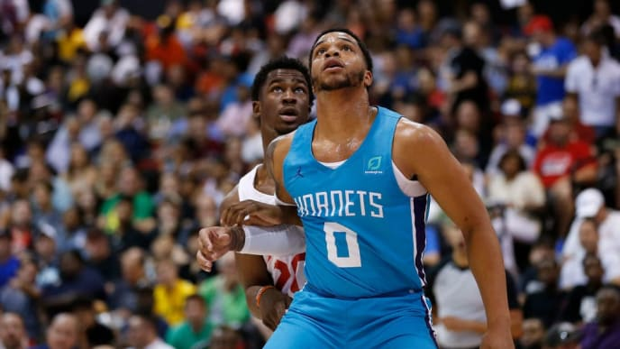 LAS VEGAS, NEVADA - JULY 10: Miles Bridges #0 of the Charlotte Hornets battles for position against Adam Mokoka #20 of the Chicago Bulls during the 2019 Summer League at the Cox Pavilion on July 10, 2019 in Las Vegas, Nevada. NOTE TO USER: User expressly acknowledges and agrees that, by downloading and or using this photograph, User is consenting to the terms and conditions of the Getty Images License Agreement. (Photo by Michael Reaves/Getty Images)