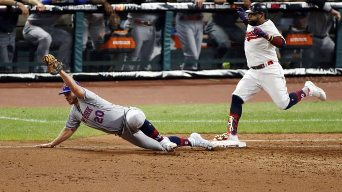 CLEVELAND, OHIO - JULY 09: Carlos Santana #41 of the Cleveland Indians and the American League is forced out at first base by Pete Alonso #20 of the New York Mets and the National League during the sixth inning in the 2019 MLB All-Star Game, presented by Mastercard at Progressive Field on July 09, 2019 in Cleveland, Ohio. (Photo by Kirk Irwin/Getty Images)