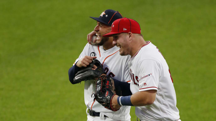 CLEVELAND, OHIO - JULY 09: George Springer #4 of the Houston Astros and the American League talks with Mike Trout #27 of the Los Angeles Angels of Anaheim and the American League (wearing #45 in honor of Tyler Skaggs) during the 2019 MLB All-Star Game, presented by Mastercard at Progressive Field on July 09, 2019 in Cleveland, Ohio. (Photo by Kirk Irwin/Getty Images)