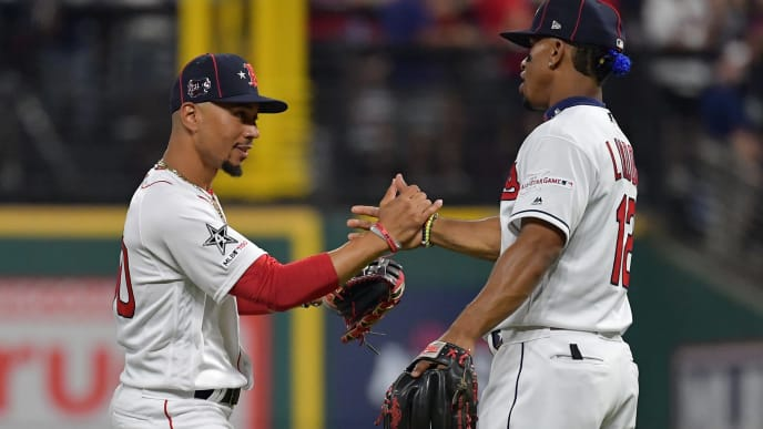 CLEVELAND, OHIO - JULY 09: Francisco Lindor #12 of the Cleveland Indians and Mookie Betts #50 of the Boston Red Sox participate in the 2019 MLB All-Star Game at Progressive Field on July 09, 2019 in Cleveland, Ohio. (Photo by Jason Miller/Getty Images)
