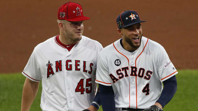 CLEVELAND, OHIO - JULY 09: Mike Trout #27 of the Los Angeles Angels of Anaheim and George Springer #4 of the Houston Astros participate in the 2019 MLB All-Star Game at Progressive Field on July 09, 2019 in Cleveland, Ohio. (Photo by Kirk Irwin/Getty Images)