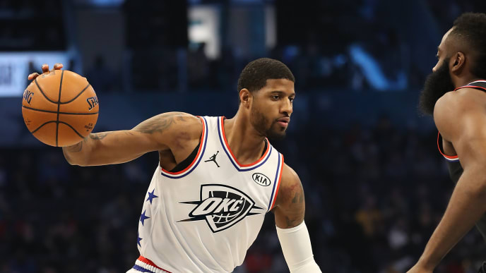 CHARLOTTE, NORTH CAROLINA - FEBRUARY 17:  Paul George #13 of the Oklahoma City Thunder and Team Giannis drives against James Harden #13 of the Houston Rockets and Team LeBron during the NBA All-Star game as part of the 2019 NBA All-Star Weekend at Spectrum Center on February 17, 2019 in Charlotte, North Carolina. Team LeBron won 178-164. NOTE TO USER: User expressly acknowledges and agrees that, by downloading and/or using this photograph, user is consenting to the terms and conditions of the Getty Images License Agreement.  (Photo by Streeter Lecka/Getty Images)