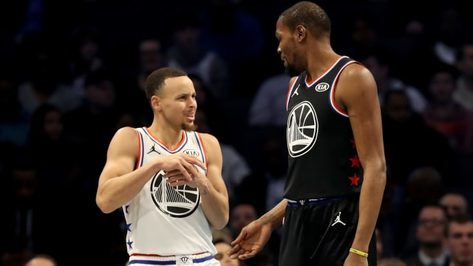 CHARLOTTE, NORTH CAROLINA - FEBRUARY 17: Stephen Curry #30 of the Golden State Warriors and Team Giannis reacts to contact from Kevin Durant #35 of the Golden State Warriors and Team LeBron during the NBA All-Star game as part of the 2019 NBA All-Star Weekend at Spectrum Center on February 17, 2019 in Charlotte, North Carolina.  NOTE TO USER: User expressly acknowledges and agrees that, by downloading and/or using this photograph, user is consenting to the terms and conditions of the Getty Images License Agreement. (Photo by Streeter Lecka/Getty Images)