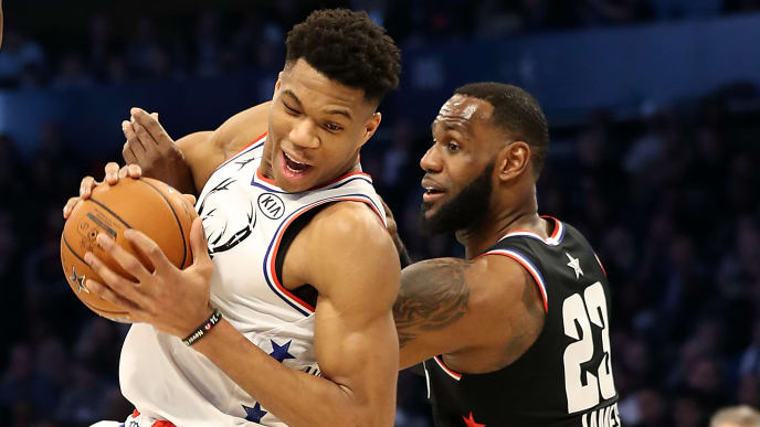 CHARLOTTE, NORTH CAROLINA - FEBRUARY 17: Giannis Antetokounmpo #34 of the Milwaukee Bucks and Team Giannis fights to keep the ball against LeBron James #23 of the LA Lakers and Team LeBron in the third quarter during the NBA All-Star game as part of the 2019 NBA All-Star Weekend at Spectrum Center on February 17, 2019 in Charlotte, North Carolina.  NOTE TO USER: User expressly acknowledges and agrees that, by downloading and/or using this photograph, user is consenting to the terms and conditions of the Getty Images License Agreement. Mandatory Copyright Notice: Copyright 2019 NBAE (Photo by Streeter Lecka/Getty Images)