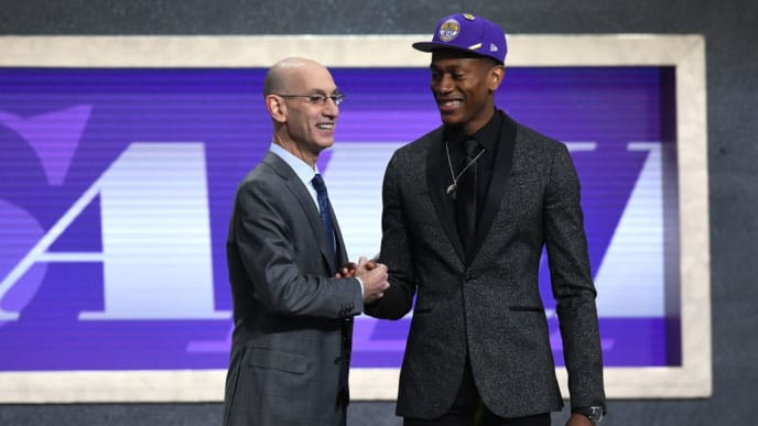 NEW YORK, NEW YORK - JUNE 20: De'Andre Hunter poses with NBA Commissioner Adam Silver after being drafted with the fourth overall pick by the Los Angeles Lakers during the 2019 NBA Draft at the Barclays Center on June 20, 2019 in the Brooklyn borough of New York City. NOTE TO USER: User expressly acknowledges and agrees that, by downloading and or using this photograph, User is consenting to the terms and conditions of the Getty Images License Agreement. (Photo by Sarah Stier/Getty Images)