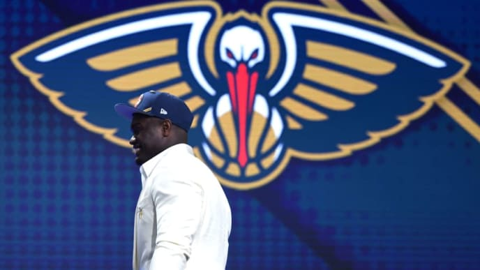 NEW YORK, NEW YORK - JUNE 20: Zion Williamson walks to the stage after being drafted with the first overall pick by the New Orleans Pelicans during the 2019 NBA Draft at the Barclays Center on June 20, 2019 in the Brooklyn borough of New York City. NOTE TO USER: User expressly acknowledges and agrees that, by downloading and or using this photograph, User is consenting to the terms and conditions of the Getty Images License Agreement. (Photo by Sarah Stier/Getty Images)