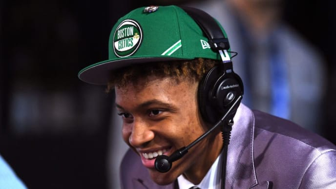 NEW YORK, NEW YORK - JUNE 20: Romeo Langford reacts after being drafted with the 14th overall pick by the Boston Celtics during the 2019 NBA Draft at the Barclays Center on June 20, 2019 in the Brooklyn borough of New York City. NOTE TO USER: User expressly acknowledges and agrees that, by downloading and or using this photograph, User is consenting to the terms and conditions of the Getty Images License Agreement. (Photo by Sarah Stier/Getty Images)