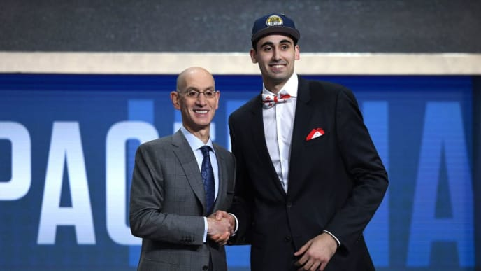 NEW YORK, NEW YORK - JUNE 20: Goga Bitadze poses with NBA Commissioner Adam Silver after being drafted with the 18th overall pick by the Indiana Pacers during the 2019 NBA Draft at the Barclays Center on June 20, 2019 in the Brooklyn borough of New York City. NOTE TO USER: User expressly acknowledges and agrees that, by downloading and or using this photograph, User is consenting to the terms and conditions of the Getty Images License Agreement. (Photo by Sarah Stier/Getty Images)