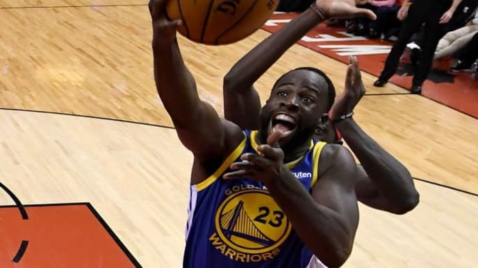 TORONTO, ONTARIO - JUNE 10:  Draymond Green #23 of the Golden State Warriors attempts a shot against Pascal Siakam #43 of the Toronto Raptors during Game Five of the 2019 NBA Finals at Scotiabank Arena on June 10, 2019 in Toronto, Canada. NOTE TO USER: User expressly acknowledges and agrees that, by downloading and or using this photograph, User is consenting to the terms and conditions of the Getty Images License Agreement. (Photo by Pool - Kyle Terada/Getty Images)