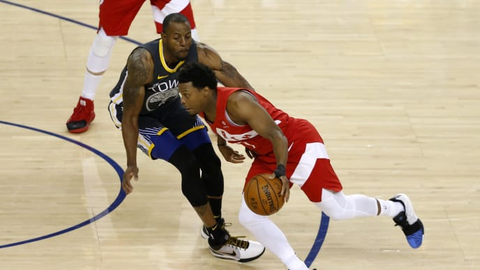 OAKLAND, CALIFORNIA - JUNE 07:  Kyle Lowry #7 of the Toronto Raptors is defended by Andre Iguodala #9 of the Golden State Warriors in the first half during Game Four of the 2019 NBA Finals at ORACLE Arena on June 07, 2019 in Oakland, California. NOTE TO USER: User expressly acknowledges and agrees that, by downloading and or using this photograph, User is consenting to the terms and conditions of the Getty Images License Agreement. (Photo by Lachlan Cunningham/Getty Images)