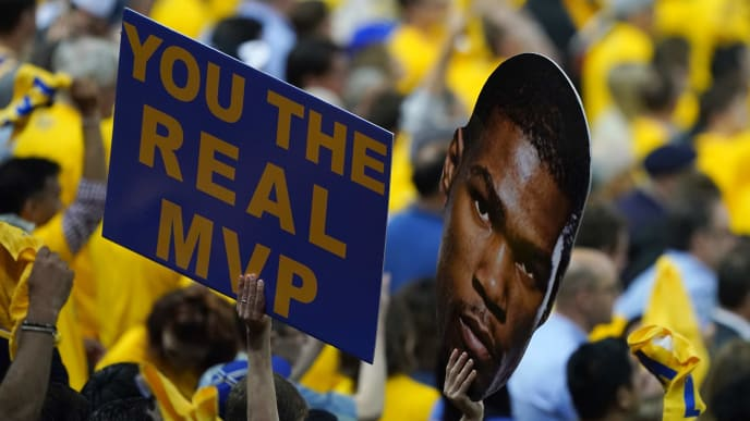 OAKLAND, CALIFORNIA - JUNE 13:  Fans hold a sign for Kevin Durant (not pictured) during Game Six of the 2019 NBA Finals between the Golden State Warriors and the Toronto Raptors at ORACLE Arena on June 13, 2019 in Oakland, California. NOTE TO USER: User expressly acknowledges and agrees that, by downloading and or using this photograph, User is consenting to the terms and conditions of the Getty Images License Agreement. (Photo by Thearon W. Henderson/Getty Images)