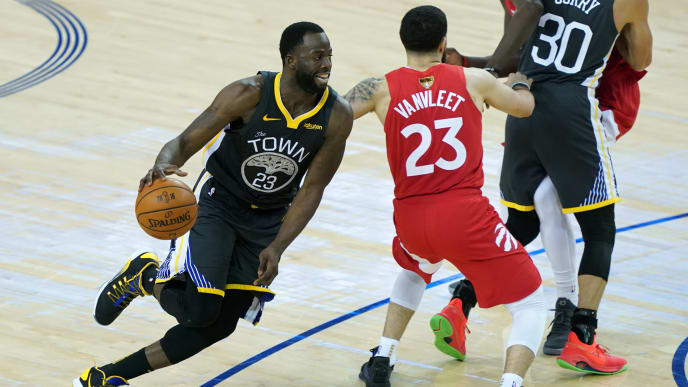 OAKLAND, CALIFORNIA - JUNE 13:  Draymond Green #23 of the Golden State Warriors drives to the basket against the Toronto Raptors in the second half during Game Six of the 2019 NBA Finals at ORACLE Arena on June 13, 2019 in Oakland, California. NOTE TO USER: User expressly acknowledges and agrees that, by downloading and or using this photograph, User is consenting to the terms and conditions of the Getty Images License Agreement. (Photo by Thearon W. Henderson/Getty Images)