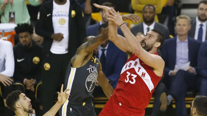 OAKLAND, CALIFORNIA - JUNE 13:  Marc Gasol #33 of the Toronto Raptors attempts a shot against Andre Iguodala #9 of the Golden State Warriors in the first half during Game Six of the 2019 NBA Finals at ORACLE Arena on June 13, 2019 in Oakland, California. NOTE TO USER: User expressly acknowledges and agrees that, by downloading and or using this photograph, User is consenting to the terms and conditions of the Getty Images License Agreement. (Photo by Lachlan Cunningham/Getty Images)